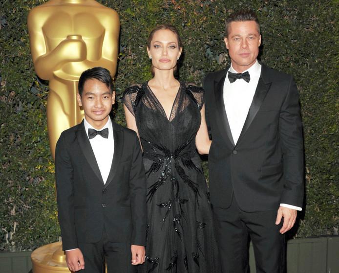 Maddox et ses parents en 2013.