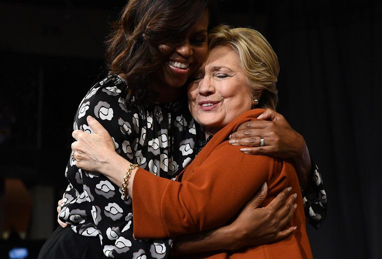 Michelle Obama en Hillary Clinton. Beeld AFP