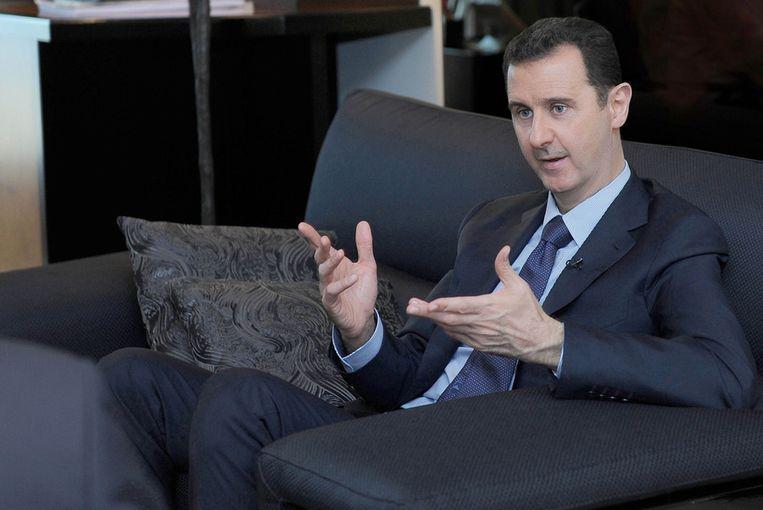 Assad tijdens een interview op 26 augustus met een Russische krant. Beeld ap