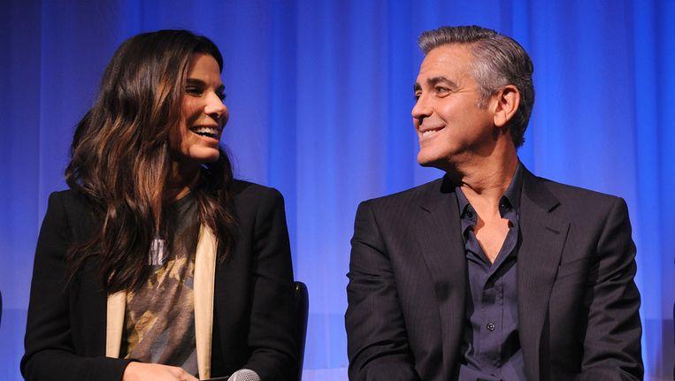 Sandra Bullock en George Clooney afgelopen week tijdens de voorstelling van Gravity voor leden van de Academy of Motion Picture Arts and Sciences, onder meer organisator van de Oscaruitreiking. Beeld getty