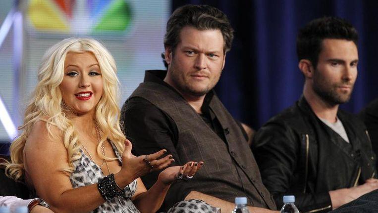 Juryleden van The Voice: Christina Aguilera, Blake Shelton en Adam Levine. Beeld reuters