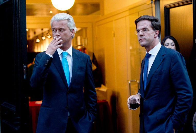 Mark Rutte en Geert Wilders tijdens de pauze van het 'premiersdebat' in 2012. Beeld anp