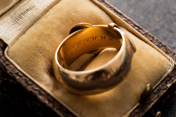 "A picture taken on October 30, 2019 at the apartment of Arthur Brand in Amsterdam shows a close-up of the 18-carat golden friendship ring with an engraving, which is said to have belonged to Irish playwright Oscar Wilde (1854-1900). - A golden ring once given as a present by the famed Irish writer Oscar Wilde has been recovered by a Dutch ""art detective"" nearly 20 years after it was stolen from Britain's Oxford University. The friendship ring, a joint gift from Wilde to a fellow student in 1876, was taken during a burglary in 2002 at Magdalen College, where the legendary dandy studied. At the time it was valued at GBP 35,000 (40,650 euros, USD 45,000). The trinket's whereabouts remained a mystery for years and there were fears that the ring -- shaped like a belt and buckle and made from 18-carat gold -- had even been melted down. But Arthur Brand, a Dutchman dubbed the ""Indiana Jones of the Art World"" for recovering a series of high-profile stolen artworks, used his underworld connections to finally find it. (Photo by JOHN THYS / AFP)"