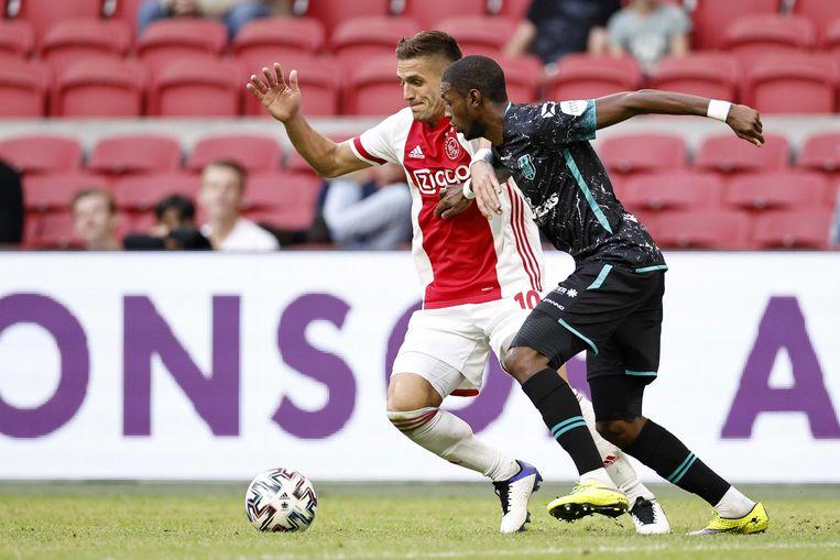 Dusan Tadic in duel met Said Bakari van RKC Waalwijk.  Beeld ANP