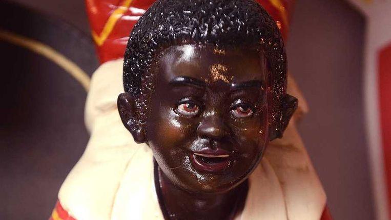 Beelden van Zwarte Piet in het Sinterklaasmuseum. Beeld anp