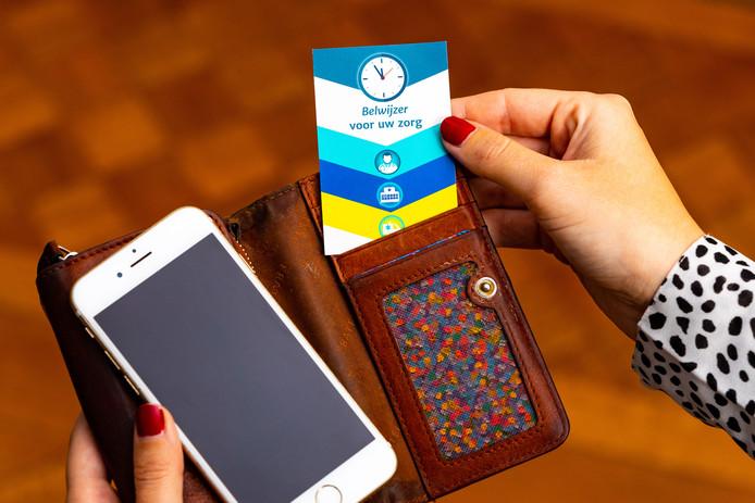 Belwijzer, folder en telefoonkaart van RAV Hollands Middel.