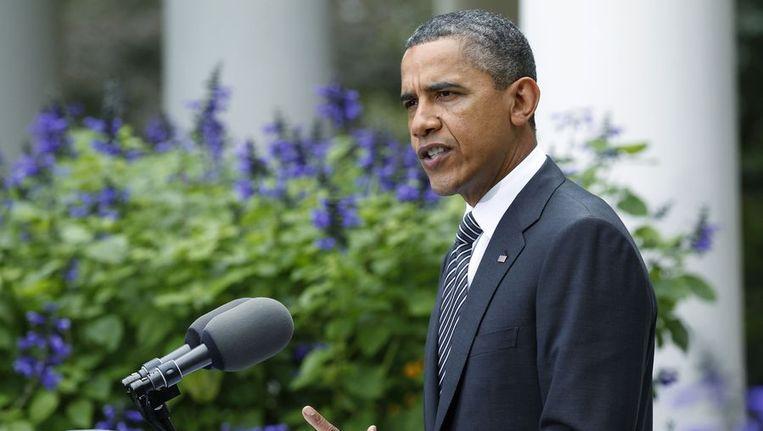 Obama gisteren in de tuin van het Witte Huis. Beeld reuters