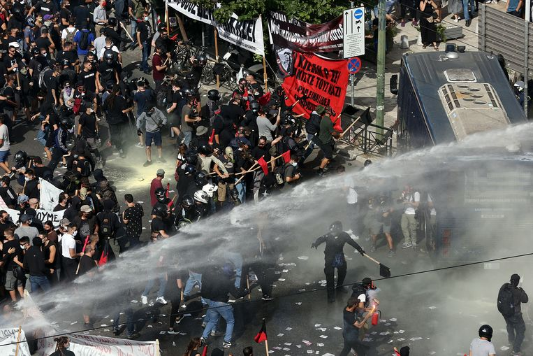Anti-Golden Days Council protesters demonstrate at the court building in Athens.  The riot police had to deploy the water cannon.
