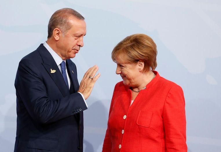 President Erdogan en bondskanselier Merkel bij de opening van de G20-top in Hamburg, 7 juli 2017. Beeld epa