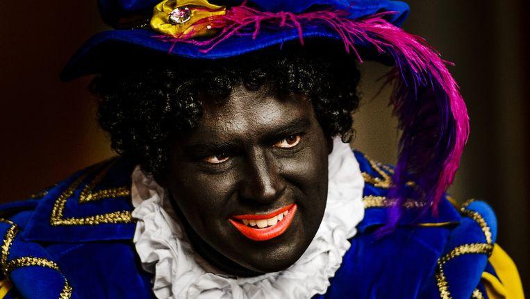 Bedrijven maken zich met het uitbeelden van Zwarte Piet schuldig aan groepsbelediging, vindt stichting Nederland Wordt Beter Beeld ANP