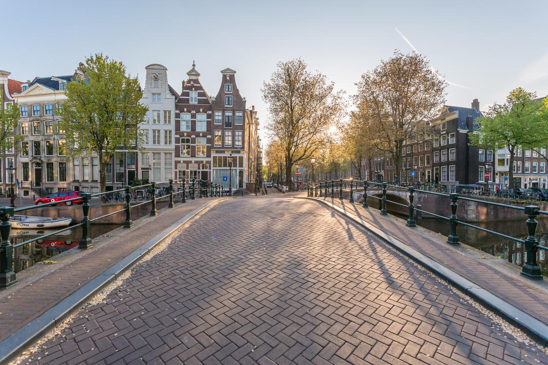 Een door het coronavirus leeg Amsterdam. Beeld Getty