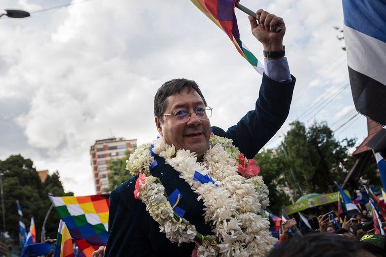 Morales' opvolger Luis Arce (57). De voormalig minister van financiën en economische zaken, kreeg volgens de prognose zo'n 5 procentpunt meer stemmen dan de ex-president in de omstreden verkiezingen van oktober vorig jaar.   Beeld Marcelo Perez del Carpio