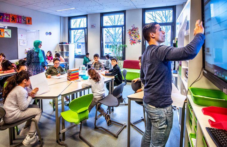 Groep 4 van de Huizingaschool in Amsterdam. Beeld Raymond Rutting / de Volkskrant