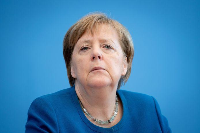 Angela Merkel roept op tot solidariteit en gezond verstand.