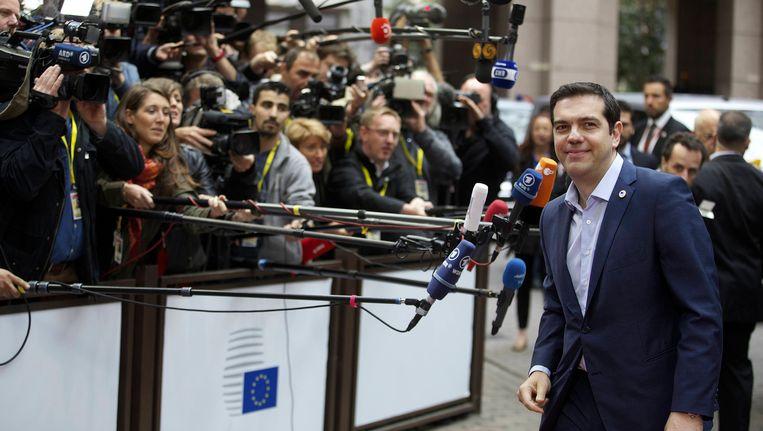 Tsipras voorafgaande aan de marathonvergadering in Brussel, waaruit een deal is voortgekomen. Beeld belga