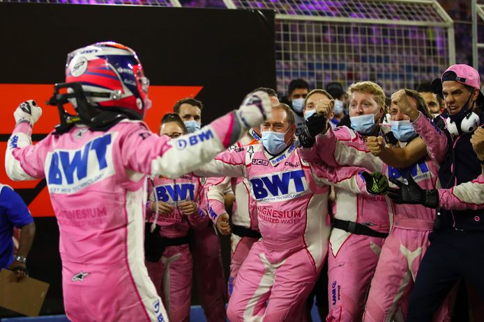 Racing Point's Mexican driver Sergio Perez (L) celebrates with his team after winning the Sakhir Formula One Grand Prix at the Bahrain International Circuit in the city of Sakhir on December 6, 2020. - Mexican Sergio Perez claimed his maiden Formula One victory in a dramatic Sakhir Grand Prix in Bahrain on Sunday. The Racing Point driver, 30, won for the first time in his 194th race, (Photo by Bryn Lennon / POOL / AFP)