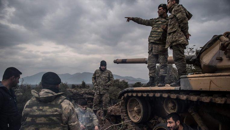 Turkse soldaten bij de Syrische grens, op weg naar Afrin, 21 januari. Beeld afp
