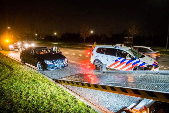 De auto's van zowel de advocaat als de politie raakten beschadigd bij een achtervolging die eindigde in Nuenen