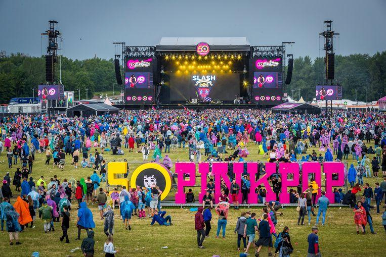 Tientallen bedrijven en duizenden mensen komen bijeen om een festival als Pinkpop mogelijk te maken. Beeld ANP