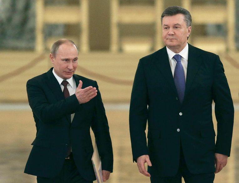 De Russische president Poetin met de toenmalige Oekraïnse president Janoekovitsj, 2013. Beeld epa
