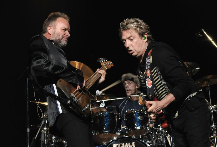 Sting, Andy Summers en Stewart Copeland van The Police tijdens hun afscheidsconcert in New York in 2008.