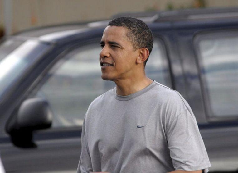 Barack Obama op Hawaii, waar hij samen met zijn gezin de kerstvakantie doorbrengt. Obama zwijgt over het aanhoudende geweld in Gaza. Foto EPA/Joaquin Siopack Beeld