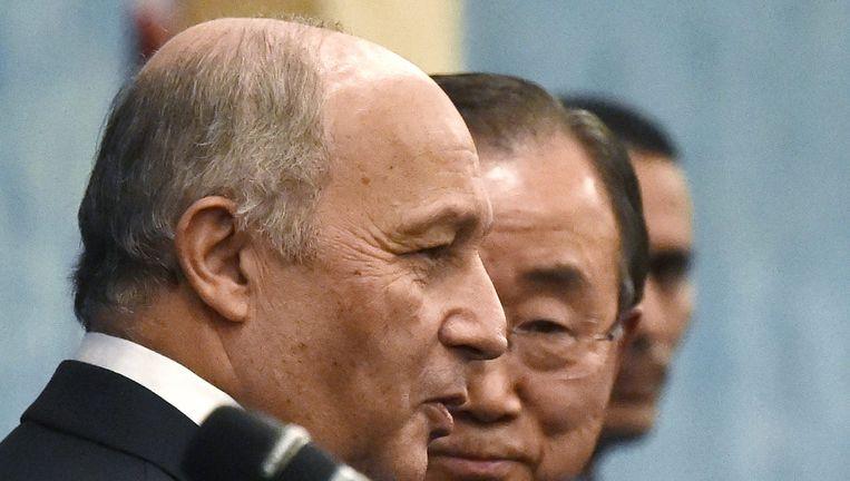 Ban Ki-Moon (R) en Laurent Fabius Beeld afp