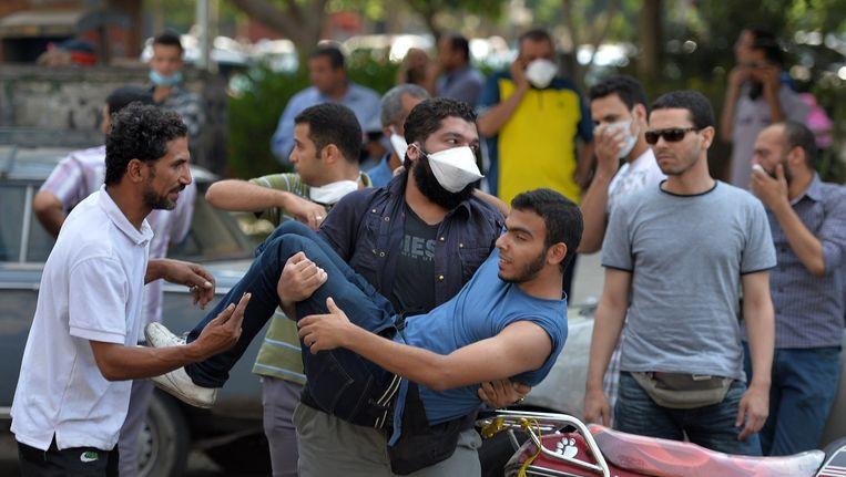 Demonstranten bij protesten in Caïro in augustus 2013 Beeld afp