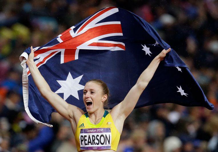 Sally Pearson wint goud op de 100 meter horden op de Olympische Spelen in Londen, 2012. Beeld AP