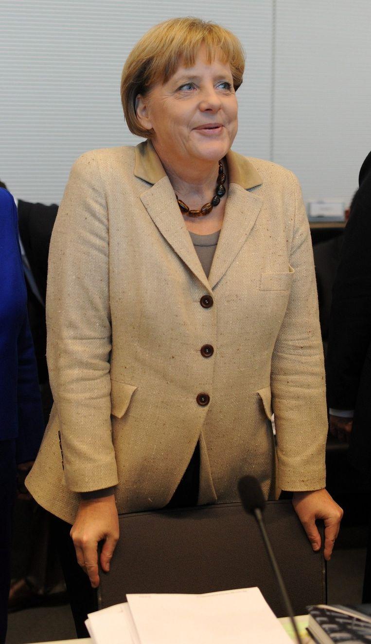 Het is vandaag een drukke dag voor Angela Merkel. Beeld epa