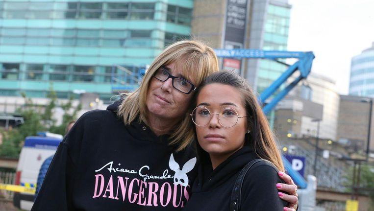 Stephanie Hill en haar dochter Kennedy wisten weg te komen. Beeld EPA