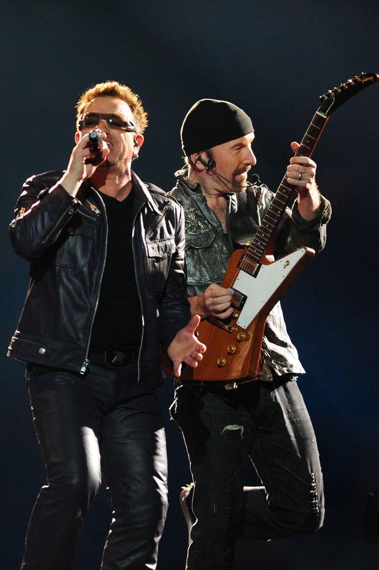 Bono en The Edge van U2, tijdens een concert in Chili, maart 2011. © AFP Beeld null