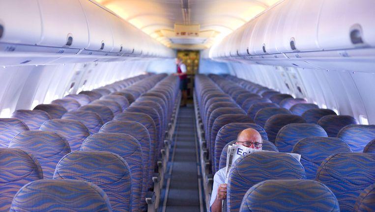 De nieuwe vliegtuigstoelen van sommige Amerikaanse luchtvaartmaatschappijen zitten iets krapper. Beeld ANP