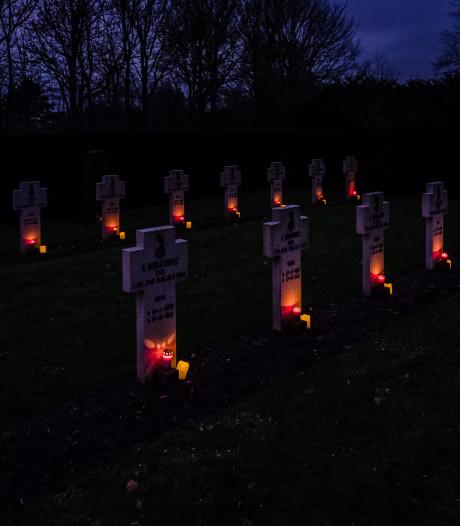 Kerstlichtjes op oorlogsgraven in Zaamslag en Axel