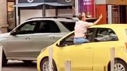 Vrouw rijdt zonder handen en botst dan tegen auto