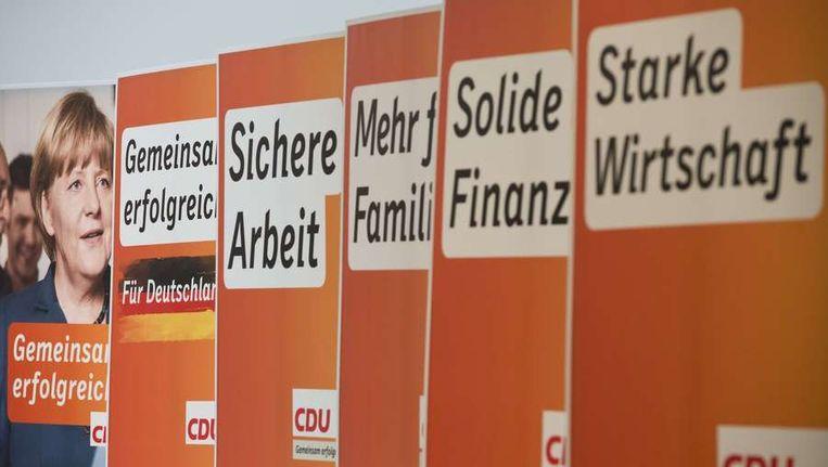 Verkiezingscampagne van de CDU, de partij van bondskanselier Merkel. Beeld afp