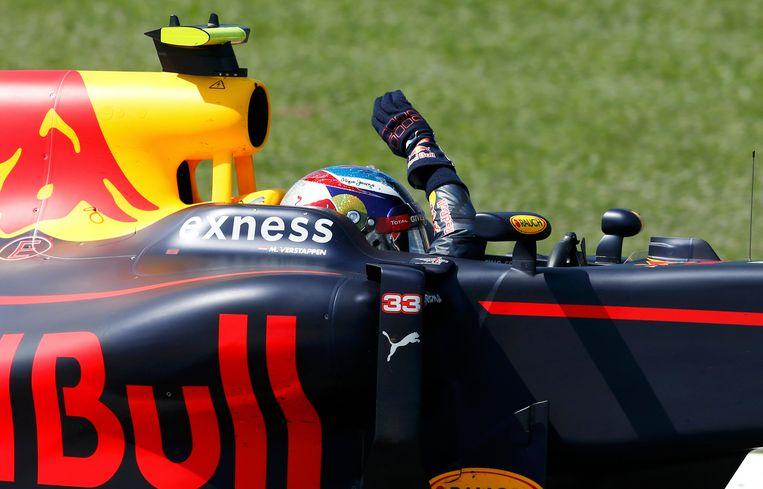 Verstappen viert de GP-zege in zijn cockpit. Beeld reuters