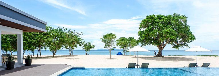 Op de plek waar eerste de huizen van vissers en boeren stonden, staat nu een toeristenparadijs. Beeld Website Huni Resort Hotel Sicogon