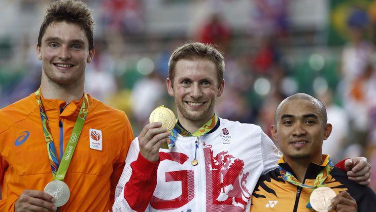 Het podium Matthijs Büchli (links), de Brit Jason Kenny en de Maleisiër Azizulhasni Awang. Beeld anp
