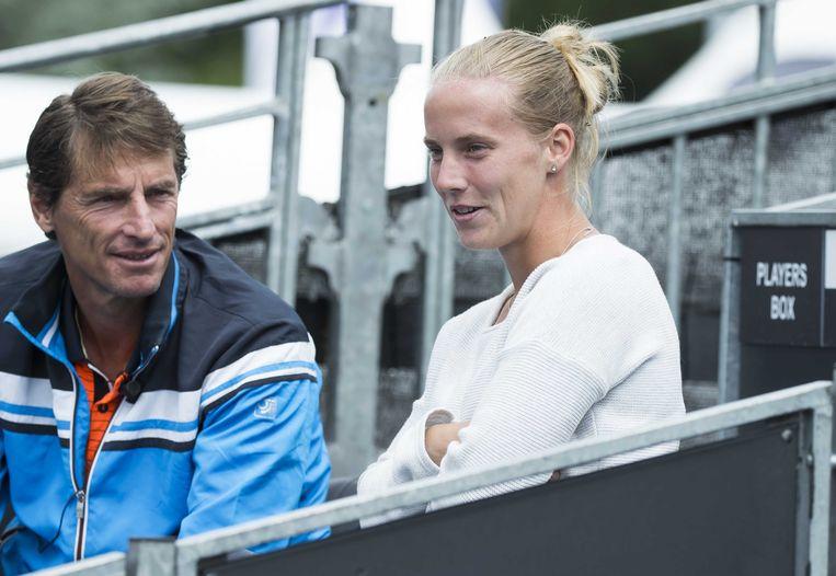 Davis Cup-captain Paul Haarhuis samen met Richel Hogenkamp deze zomer bij het Ricoh Open Tennis.  Beeld ANP