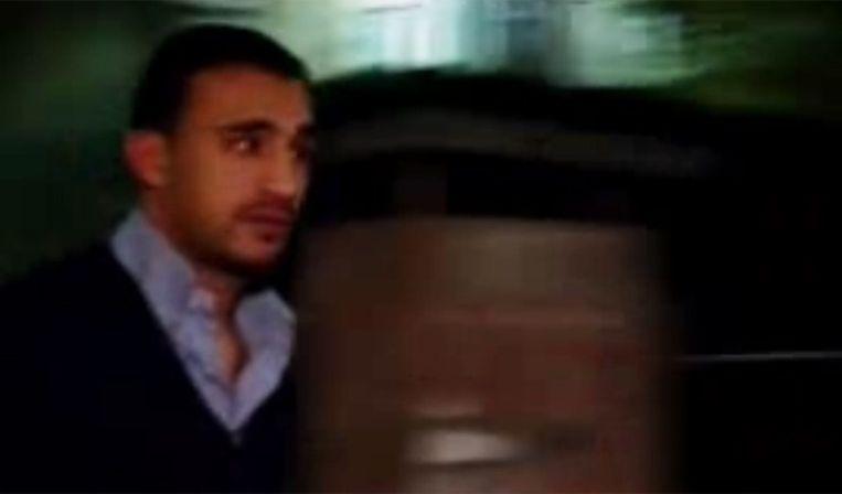 Badr Hari bij zijn arrestatie vanavond. Beeld SCREENDUMP POWNED