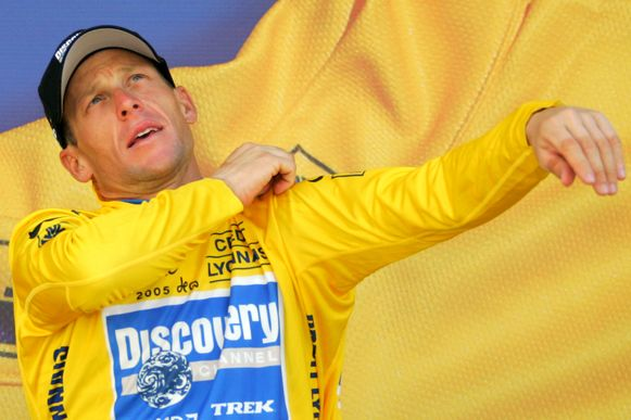 FILE - In this July 22, 2005 file photo overall leader Lance Armstrong, of Austin, Texas, pulls on the yellow jersey on the podium after the 19th stage of the Tour de France cycling race between Issoire and Le Puy-en-Velay, central France. (AP Photo/Peter Dejong, file)