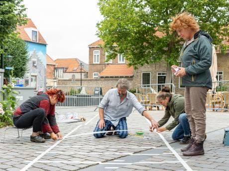 Regen en wind spelbreker bij straatschildering zebrapad voor gekke loopjes