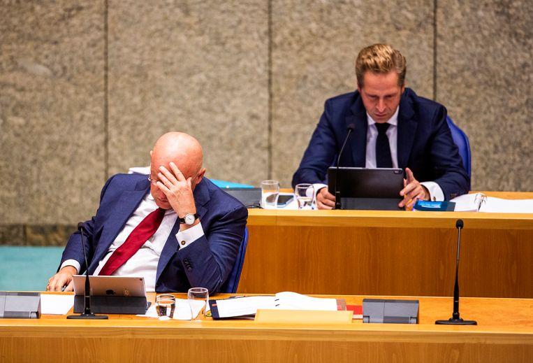 Minister Grapperhaus woensdag in de Tweede Kamer tijdens het debat waarin zijn positie ter discussie staat. Op foto's van zijn huwelijksfeest is te zien dat hij en zijn gasten zich niet aan de anderhalvemeterregel hebben gehouden. Beeld Jiri Büller