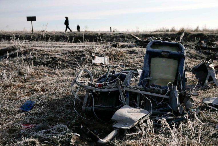 Wrakstukken op de plek waar de vliegtuigramp met MH17 plaatsvond, afgelopen zomer. Beeld REUTERS