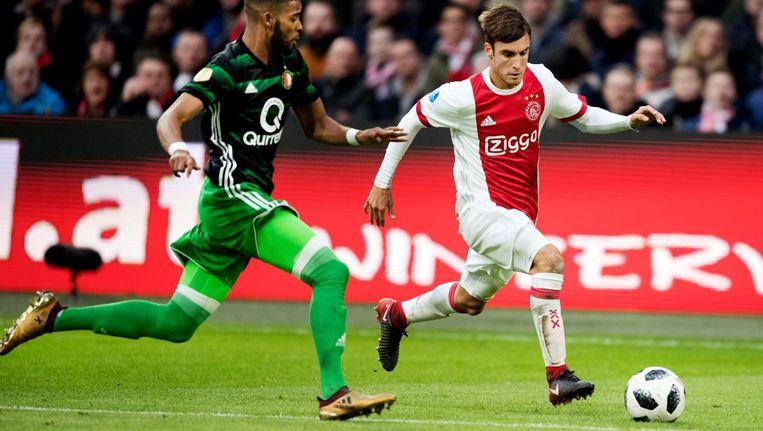Tagliafico van Ajax in duel met Jeremiah St Juste van Feyenoord. Beeld anp