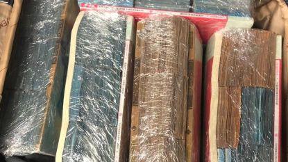 Passagier in luchthaven Dusseldorf geklist met 870.000 euro vermomd als Chinese boeken