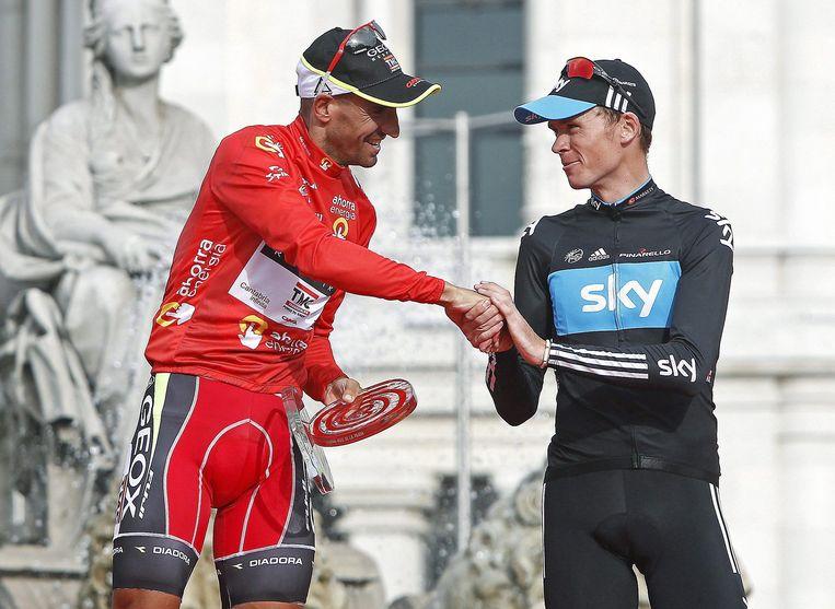 Juan José Cobo (links) en Chris Froome op het eindpodium na de Ronde van Spanje in 2011. Beeld EPA