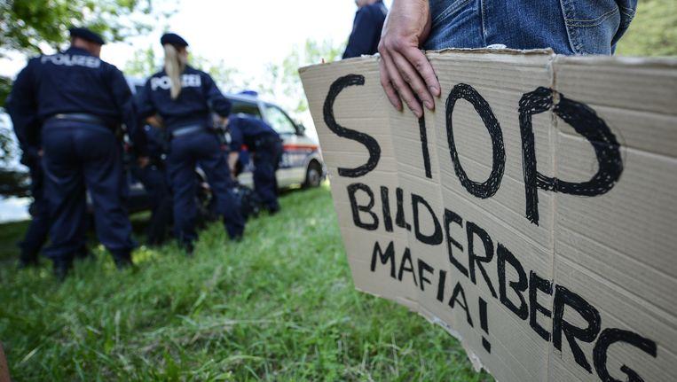 Onder zware bewaking en met demonstranten ging vandaag de Bilderbergconferentie van start. Beeld Getty Images