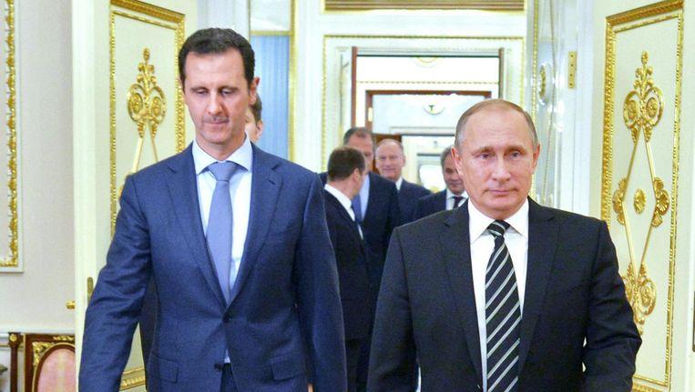 Poetin en Assad in 2015 in Moskou. Beeld epa